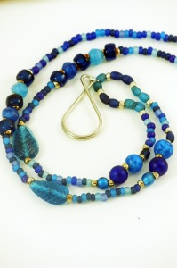 blue glass beaded lanyard with leaves and silver badge holder