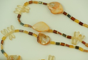dyed shell and cut glass lanyard in gold tones 2