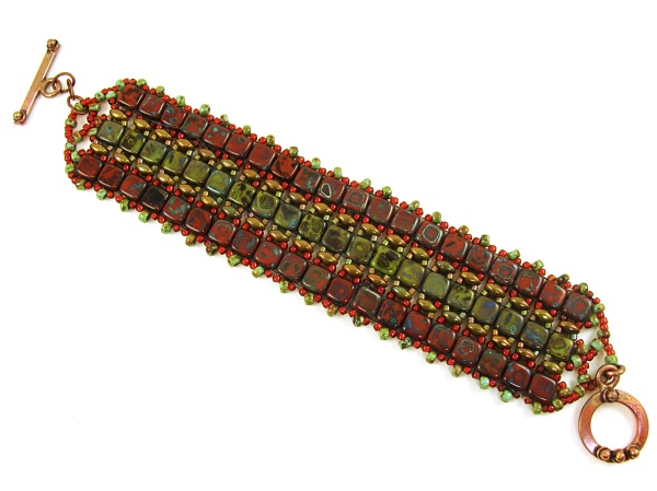 Brick red and green Tilas with green/gold Superduos. Handmade brass toggle clasp