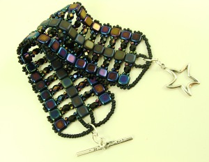 Peacock blue fire polished crystals and Tila squares. Blingity Bling Bling!!