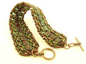 Similar Tila and seed bead colors, with gold Super duos in a narrower bracelet