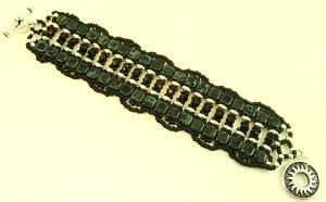 Bold black and silver bracelet with sunburst toggle clasp