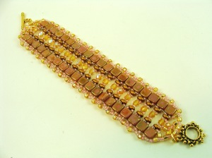 Mauve and gold with pink seed beads and fire-polished crystals in AB finish down the center